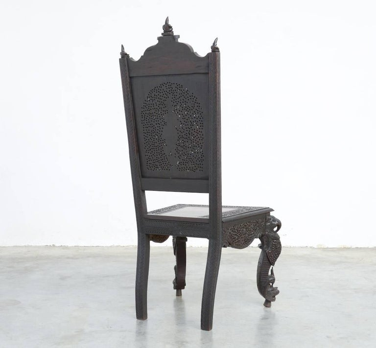 This extraordinary Anglo-Indian carved hardwood side chair can be dated in the late 19th century.