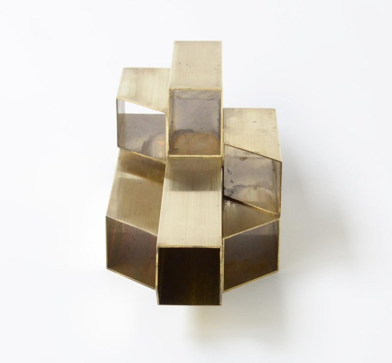 This geometric brass sculpture can be dated in the 1970s.