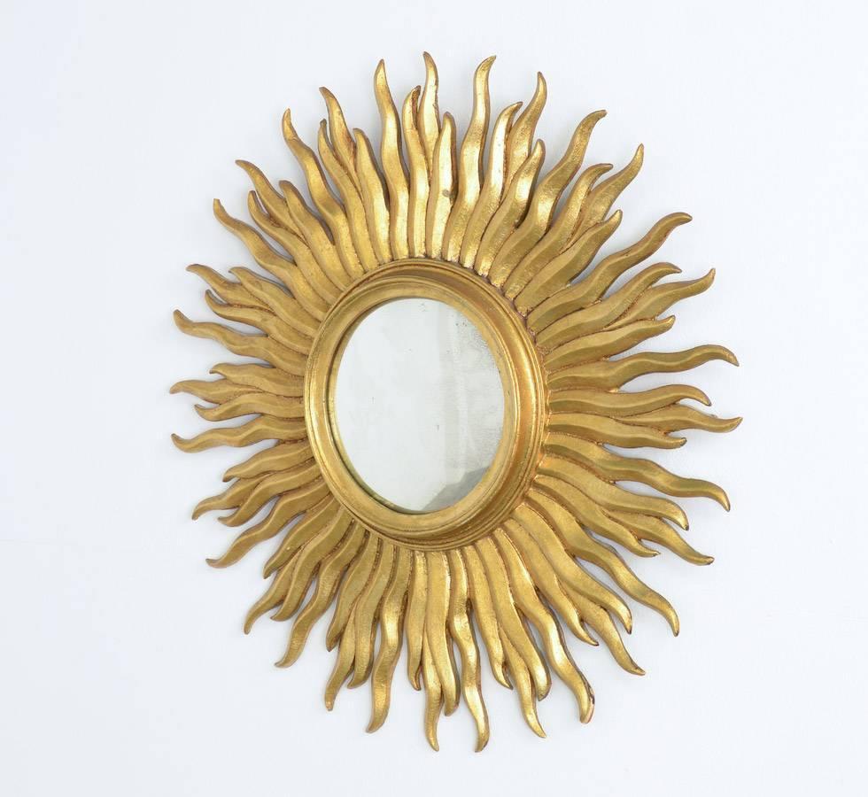 Dynamic sunburst mirror at 1stdibs for Sunburst mirror