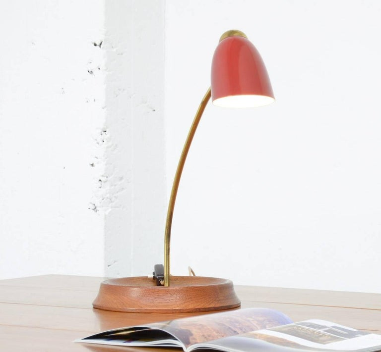 This unique table lamp is an Italian design of the 1950s.