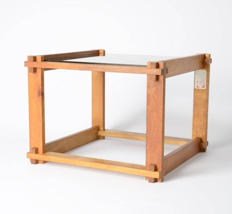 This nice cubist side table can be dated in the 1960s. The wooden cubic frame is sophisticated made, it is nice with the mirror glass top. This side table is in very good condition. Let the pictures convince you. The Dutch designers and
