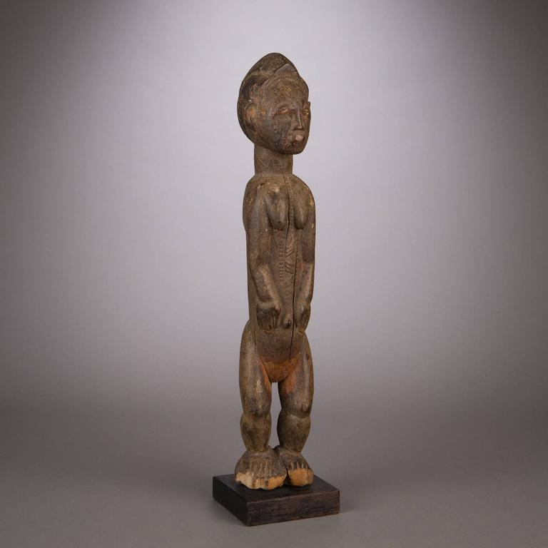 Divinatory figures among the Baule were used as dwellings of asye usu, or bush spirits, incorporeal consciousness's from outside the village bounds brought into communication with the diviner. Such figures were designed as ideal male or female