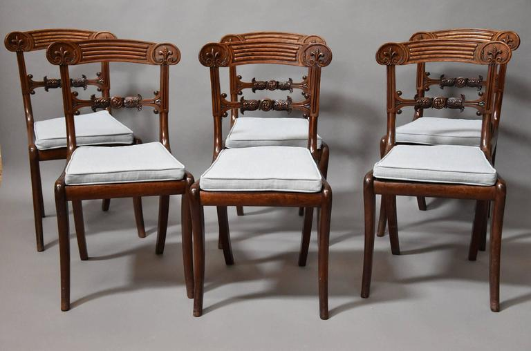 A superb set of eight Regency mahogany dining chairs in exceptional original condition and of superb patina (color).   This set of chairs consists of two armchairs and six single chairs which form a good set of eight dining chairs.  The chairs