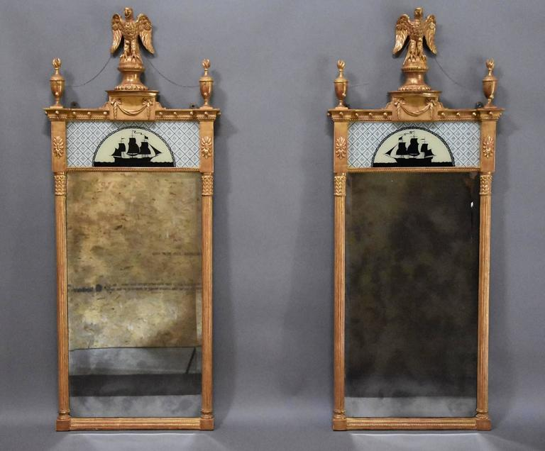 A superb pair of early 20th century carved giltwood pier mirrors in the Regency style.
