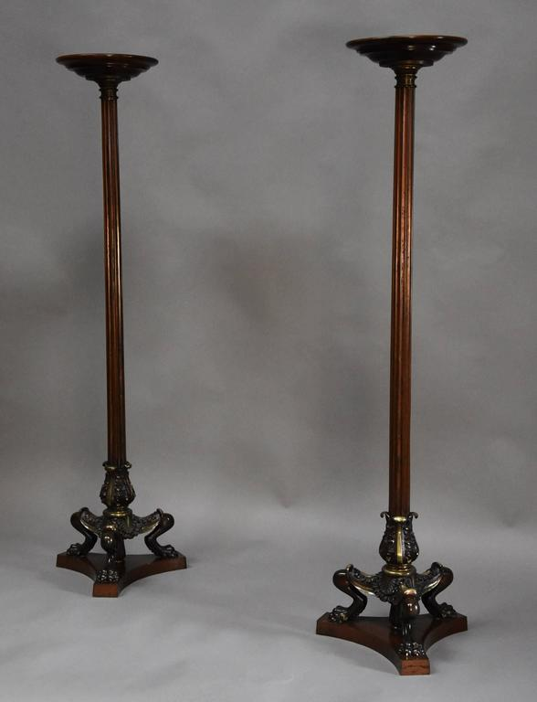 A superb pair of Regency style bronze and mahogany torcheres in the manner of George Smith or Thomas Hope and being in the Egyptian style which was a typical influence in this period.  The torcheres each consist of a circular mahogany top leading