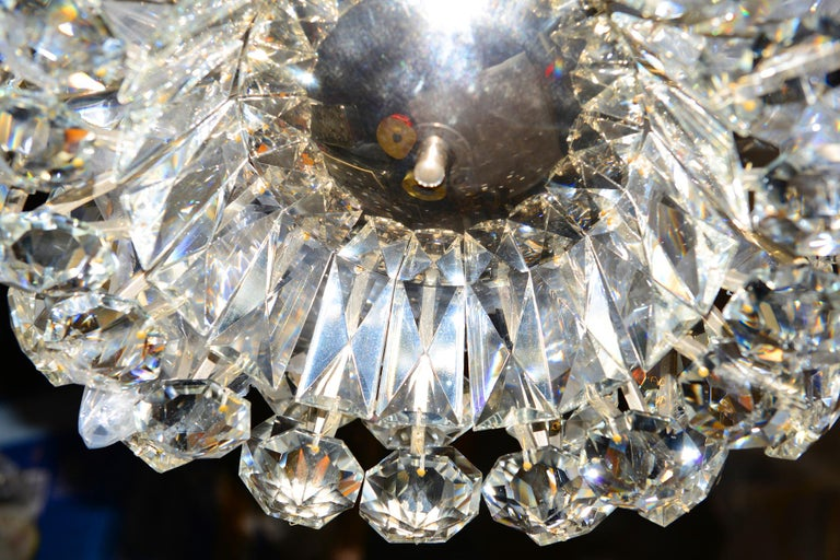 A significant Bakalowits chandelier from 1960 with a mirror on the bottom and very large glass-stones Total drop custom made.