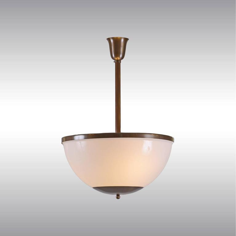 Ceiling light with Opaline glass shade.