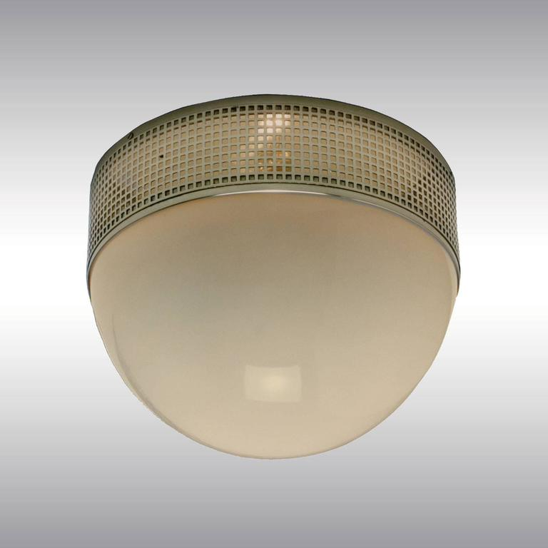 Very elegant flush mounted ceiling-lamp, light comes out and makes wonderful pattern on the ceiling. This lamp is as well available in a larger version: 50 cm (19.69 inch). Please contact upon request.   All components according to the UL