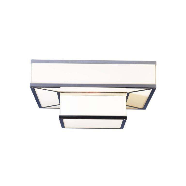 Puristic ceiling-lamp. The light shines out the punched sheet look at other image. There is as well a glass-only version available. 