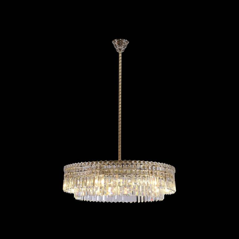 Sensational found from the 1950s. Brilliant chandelier with high quality hangings and brass-covered iron-frame and stem. Mirror on the bottom. The total drop is 116cm, the stem can be shortened, the height of the chandelier itself is 22cm and the