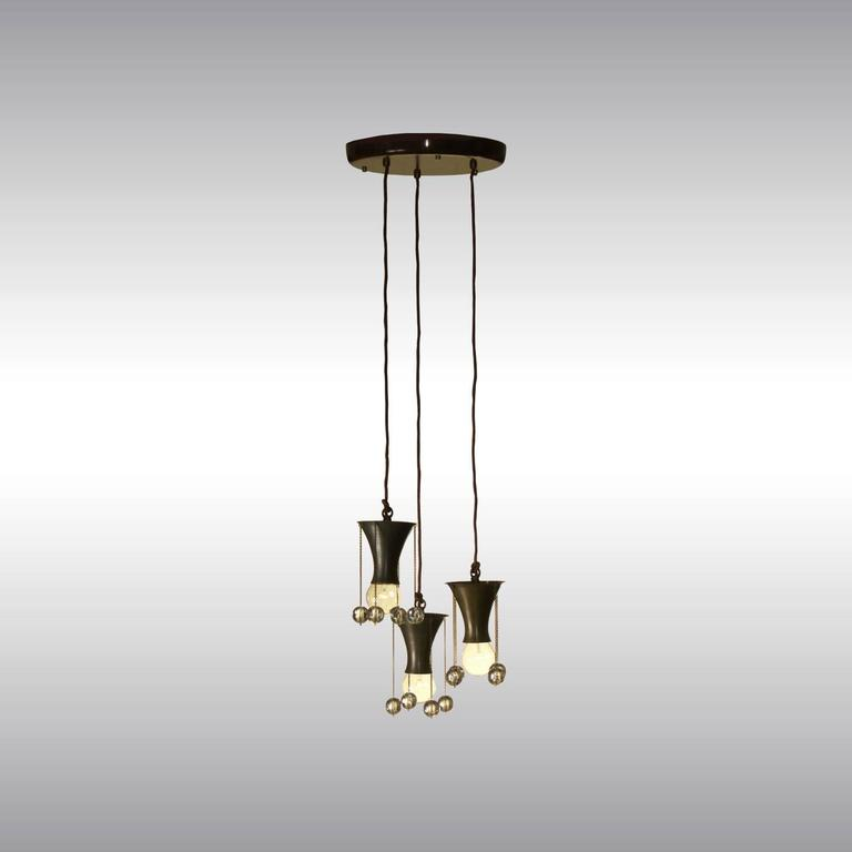 Pendant, used in several Versions in Showrooms of the Wiener Werkstätte. ALSO AVAILABLE IN A SINGLE VERSION Originally manufactured at the Wiener Werkstätte Atelier, now custom-made production at the Woka Lamps Workshop in Vienna. Weight: 6 kg (2.73