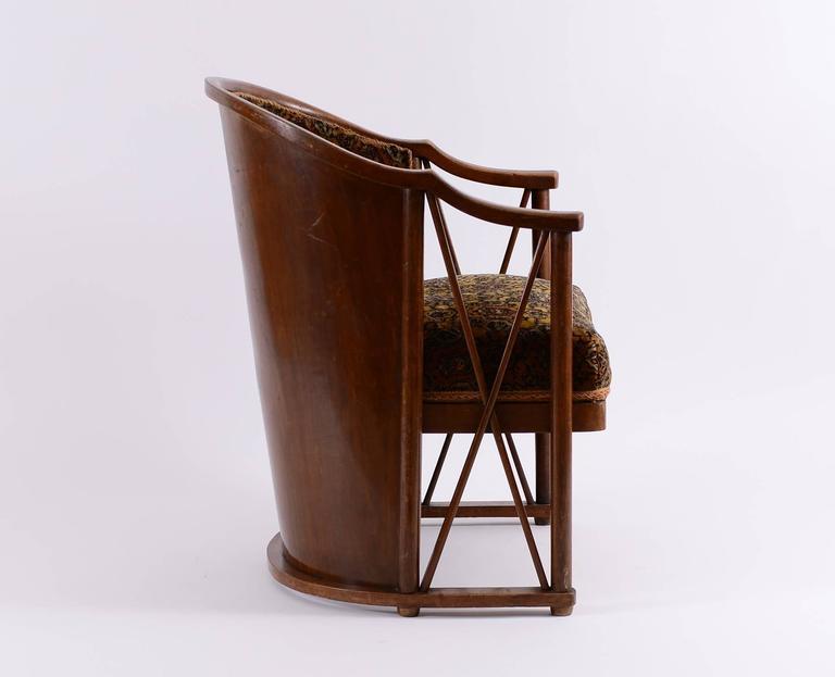 Extremely rare armchair in bentwood, original condition, original fabric, manufactured by Jacob & Josef Kohn.   Enclosed an image from the Exposicion Internacional de Centenario in Buenos Aires in 1910, Max Eisler,Österreichische Werkkultur 1916,