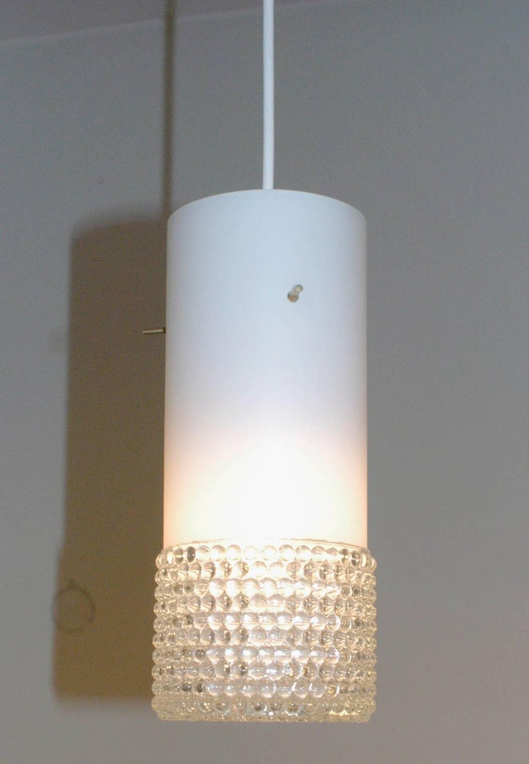 Set of three cylindrical opaline and bubble glass pendant lights with brass fittings, probably manufactured by Staff Leuchten Germany in the 1960s.