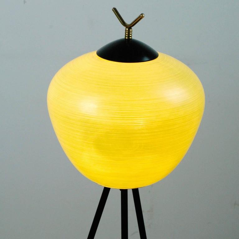Metal Italian Midcentury Iron, Brass and Yellow Glass Tripod Floorlamp by Stilnovo For Sale