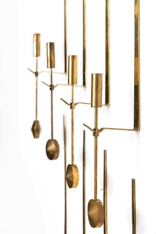 Large set of wall candlesticks designed by Pierre Forsell. Produced by Skultuna in Sweden.