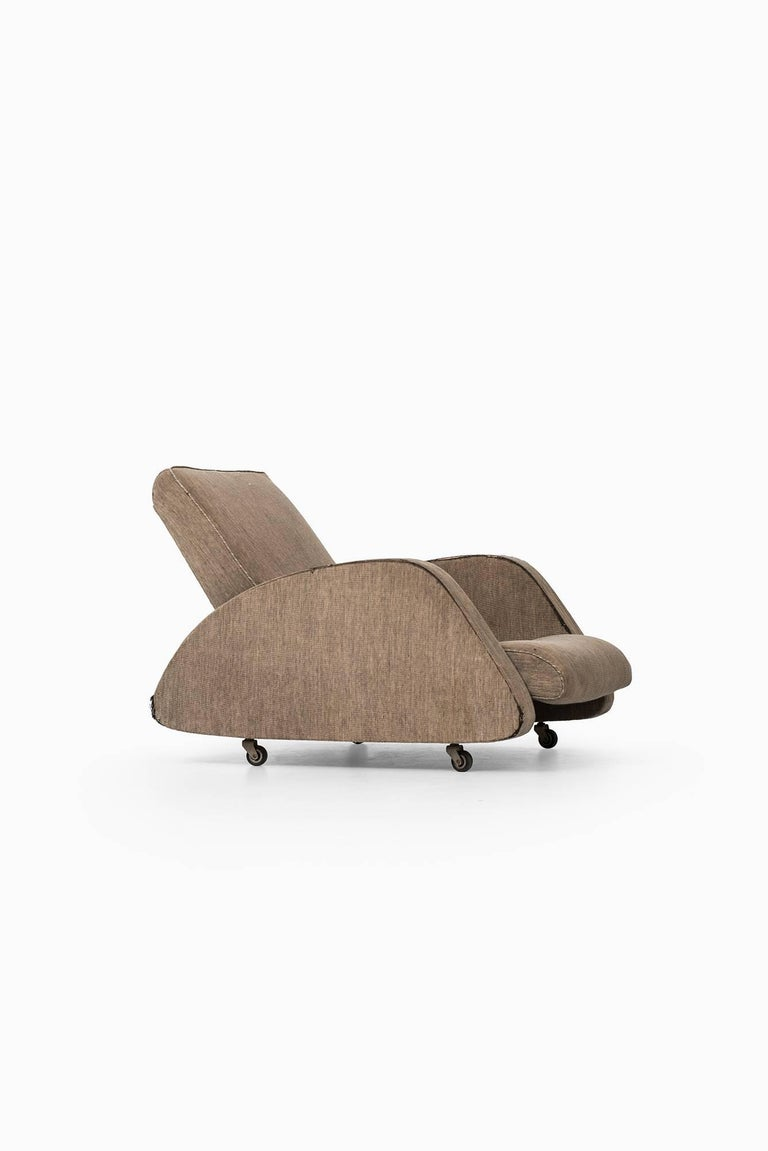 Rare easy chair designed by Bo Wretling. Produced by Otto Wretling in Umeå, Sweden.