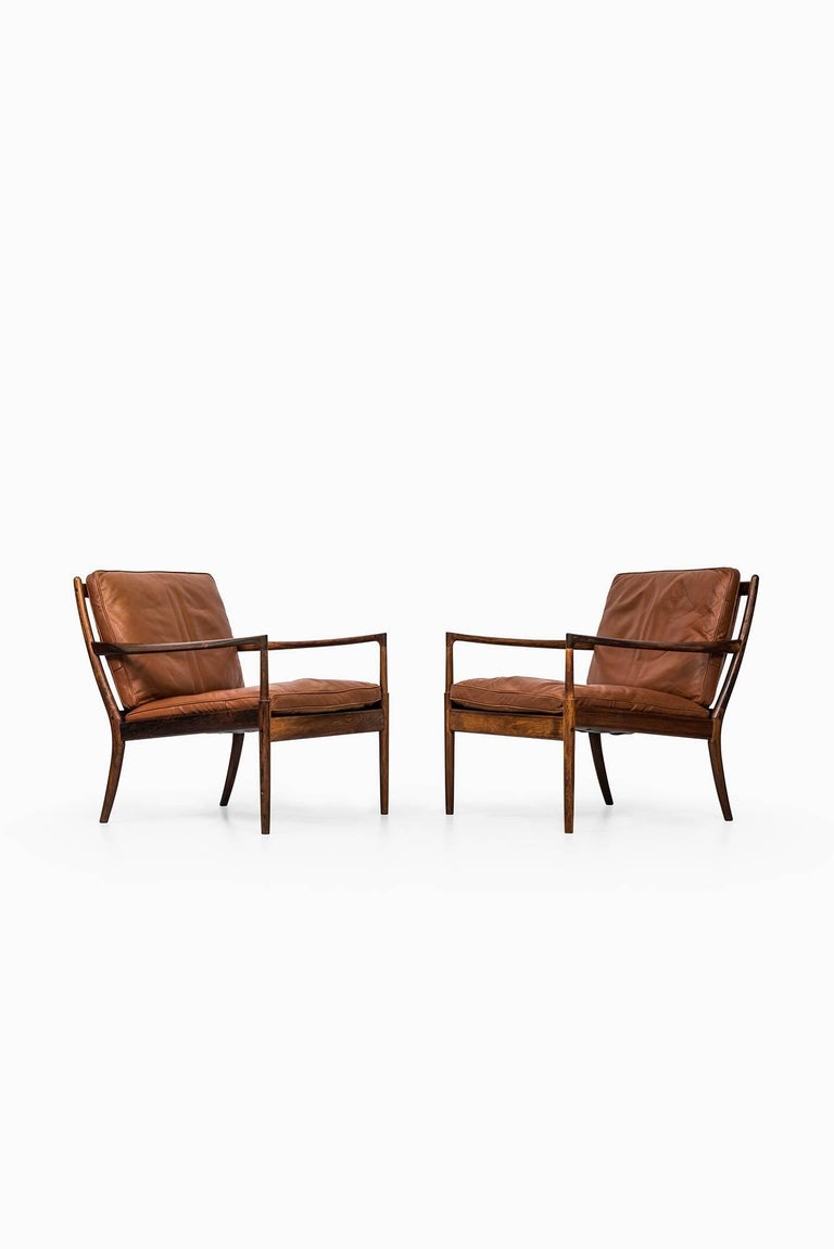 Mid-20th Century Rare Pair of Easy Chairs Model Samsö Designed by Ib Kofod-Larsen Produced by OPE For Sale