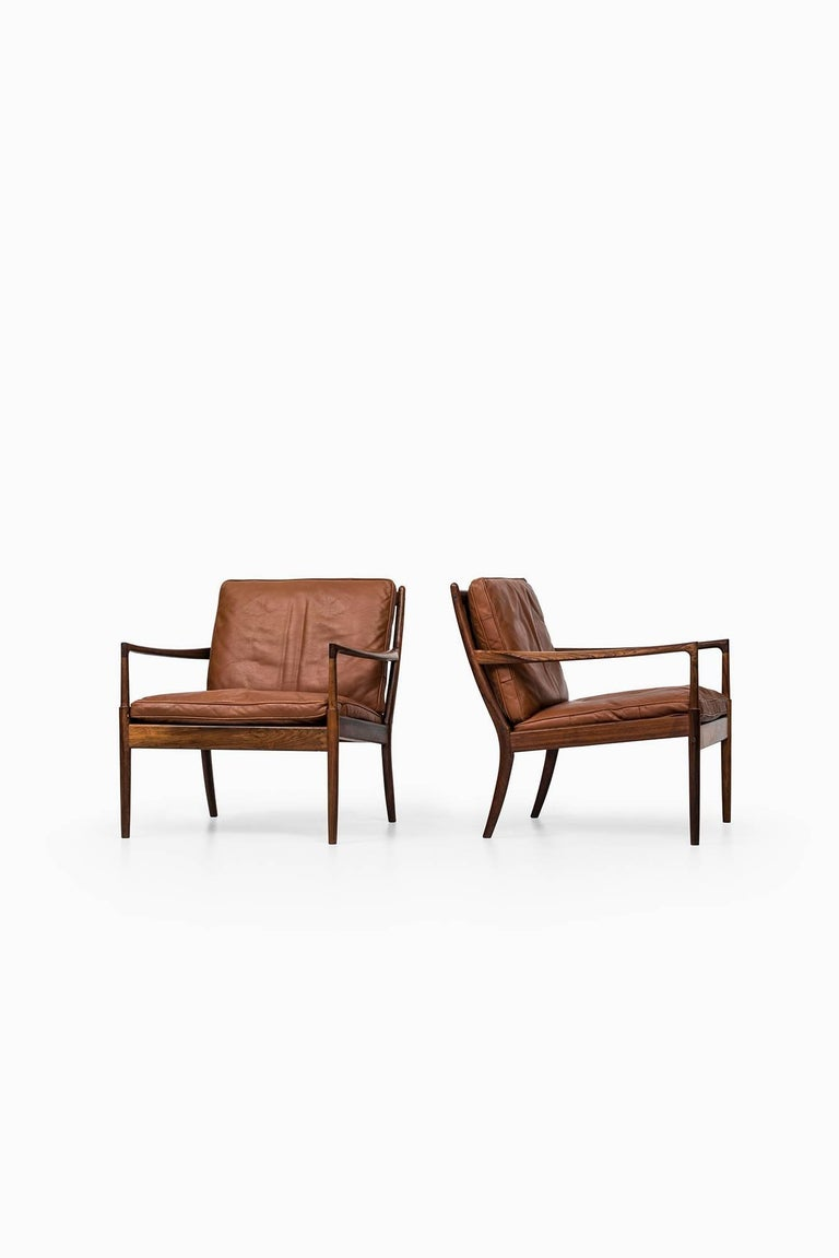 Rare pair of easy chairs model Samsö designed by Ib Kofod-Larsen. Produced by OPE in Sweden.