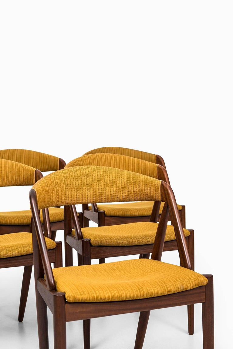 Set of six dining chairs designed by Kai Kristiansen. Produced by Schou Andersen in Denmark.