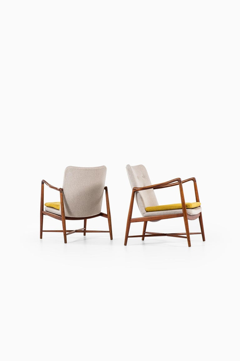 Rare pair of easy chairs model BO59/ fireplace chair designed by Finn Juhl. Produced by Bovirke in Denmark. Teak and newly reupholstered in grey and yellow fabric.
