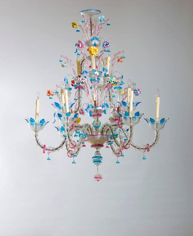 Included in the offer the rewiring for US and frame colored in silver color.   Elegant Italian Venetian, Ca' Rezzonico Chandelier, blown Murano Glass, in transparent color with multicolored refinishing, composed by nine arms, with three fantastic