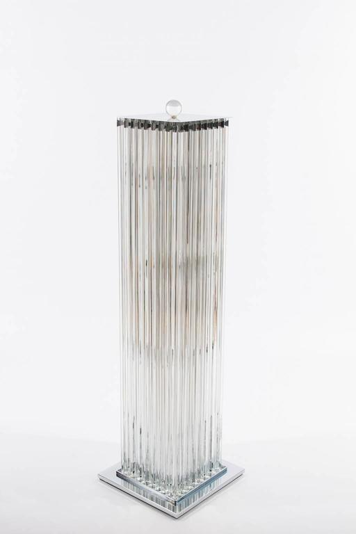Elegant Floor Lamp in blown Murano Glass clear color with triedros elements, 1990s Italy.  This limited editions floor lamp has an amazing cubic squared shape composed by transparent glass triedro elements allocated in a chromed frame. At its top, a