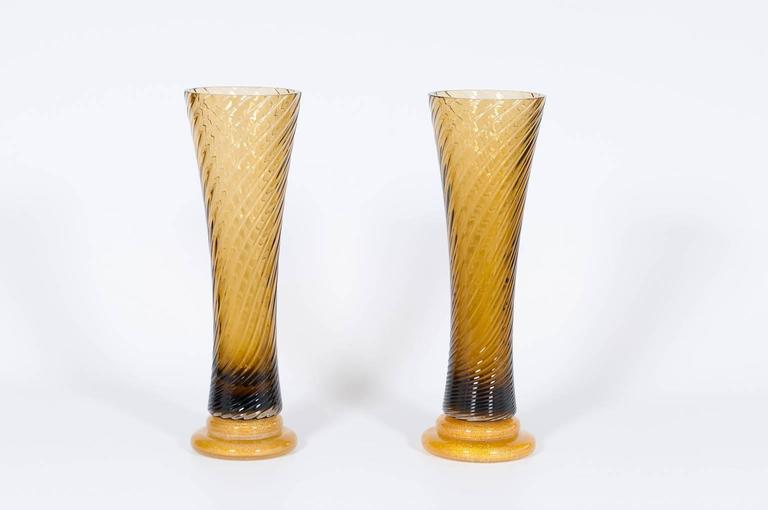 Pair of elegant Italian Murano glass vases in amber and gold, attributed to Seguso around 1980s in very excellent original condition. The Vases are 18.50 inch high, by 5.71 inches diameter.