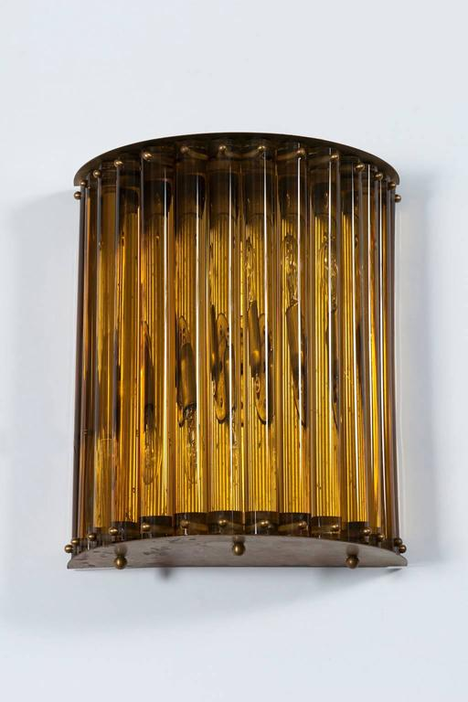 Massive single Wall Sconce in blown Murano Glass in amber color 1960s Italy. This single sconce is a work of art that is adapt to be installed in yard or garden is properly protected from the rain, as well as inside a building. This is an