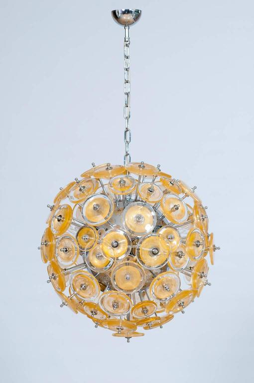 Amazing and Spectacular Italian Venetian, Flush Mount, Blown Murano Glass, Gold 24-K, composed by circular discs in transparent glass with in the middle a circular gold submerged leaf; all elements are accommodated in a chromed frame.  The Flush
