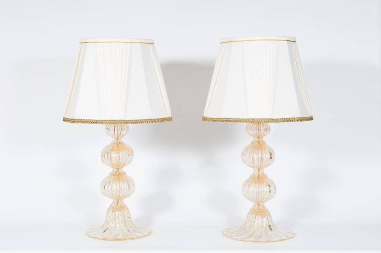 Pair of Italian Venetian table lamp in Murano glass gold, with bubbles submerged inside glass, in very perfect original condition, attributed to Barovier & Toso, circa 1970s.