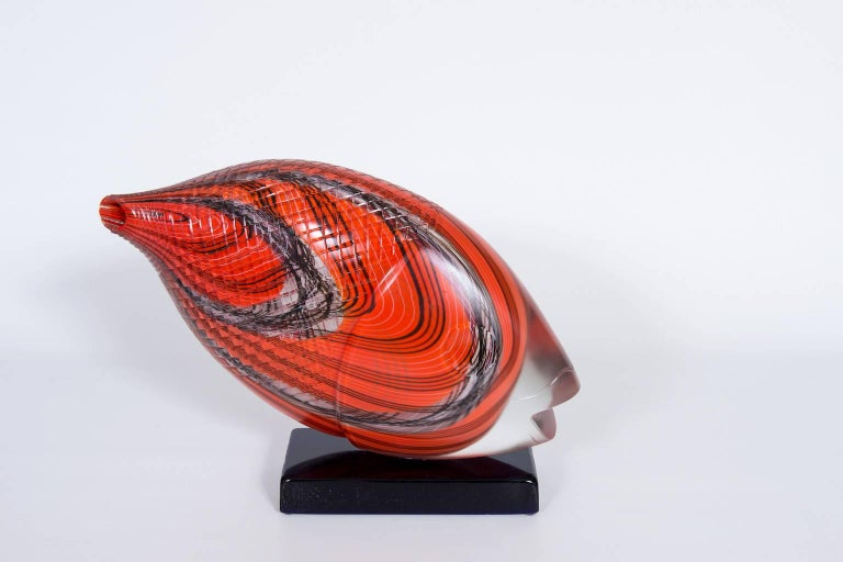 Astonished Italian Venetian, Fish Sculpture, Blown Murano Glass, Red, Opaque, Black, 1990s. This amazing sculpture is composed by a black basement all in blown Murano glass, where the fish abstract sculpture is accommodated. The abstract fish is a