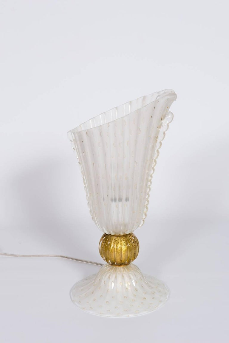 Unique Italian Table Lamp in Blown Murano Glass White and 24-Karat Gold finishes,  1970s, with an unique and amazing design, supported by its original brass frame.  Entirely manufactured and designed  in the Italian Venetian Murano Island, 1970s.