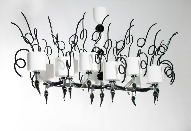 Curly Chandelier black and white in blown Murano Glass contemporary Italy The chandelier is composed by a fantastic chromed framework, where twelve arms  are disposed in different heights generating a gorgeous artwork. Each arm supports a