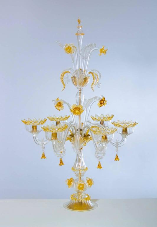 Amazing, Italian Venetian, table lamp flambeau, blown Murano glass, amber white, composed by two gardens. In the first garden having the six arms, and the low and high leafs, whit high flowers; while the second garden is composed by low and high