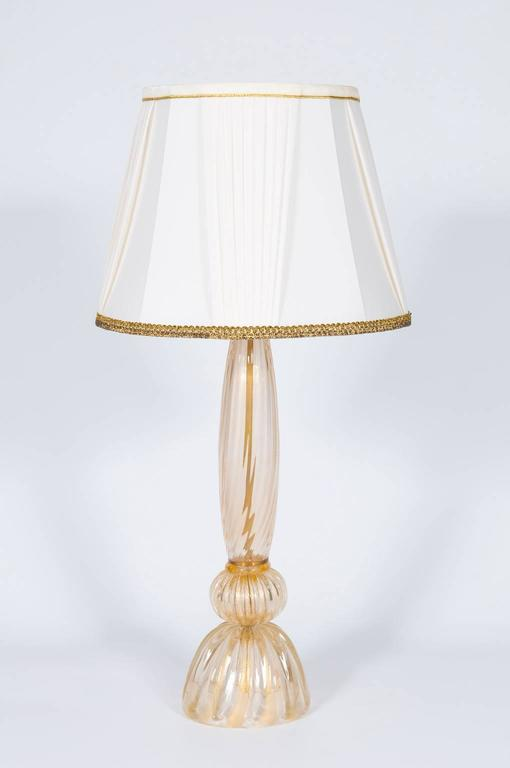 Handcrafted Gold Italian table lamp in Murano glass, composed from a gold striped base with above a sphere and from a gold striped stem, with one light over. The Table lamp is in very excellent original condition, made circa 1980s. We can