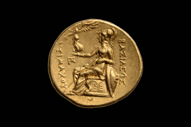 One of the most beautiful portraits of Alexander the Great, in gold, known.  This stunning gold stater minted under King Lysimachos depicts one of the earliest known portraits of Alexander the Great, in superb Hellenistic style, dating to 297 - 281