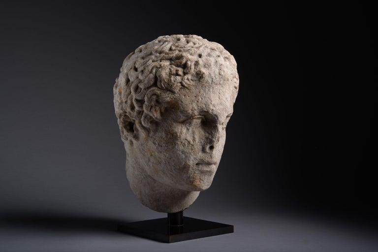 A Hellenistic over lifesize marble head of an athlete, circa 300 BC.