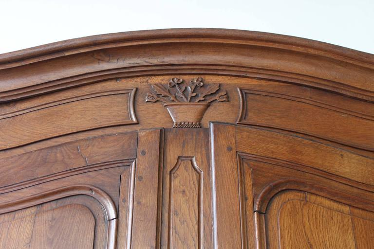 French buffet a deux corps, likely late 18th or early 19th century, made of walnut. Two doors over two small drawers and two doors in the buffet base. Functioning lock and key with original brass hardware.   Very good overall condition, note the