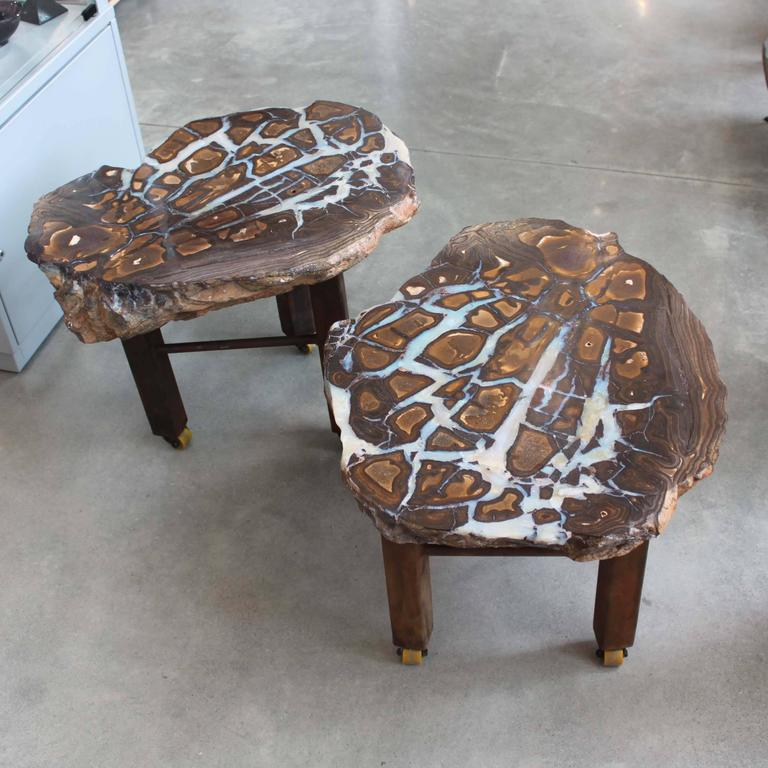 A pair of stunning boulder opal side tables with custom iron bases. The opal veins exhibit a full spectrum of color, especially visible under direct light.   Boulder opal is one of the most valuable varieties of opal, second only to Australia's