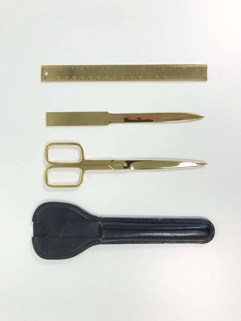 Gold-plated desk set by Asprey includes the following:  1 x Scissors 1 x Letter opener 1 x Ruler 1 x Leather case.  In excellent overall condition with minor wear consistent with regular use.