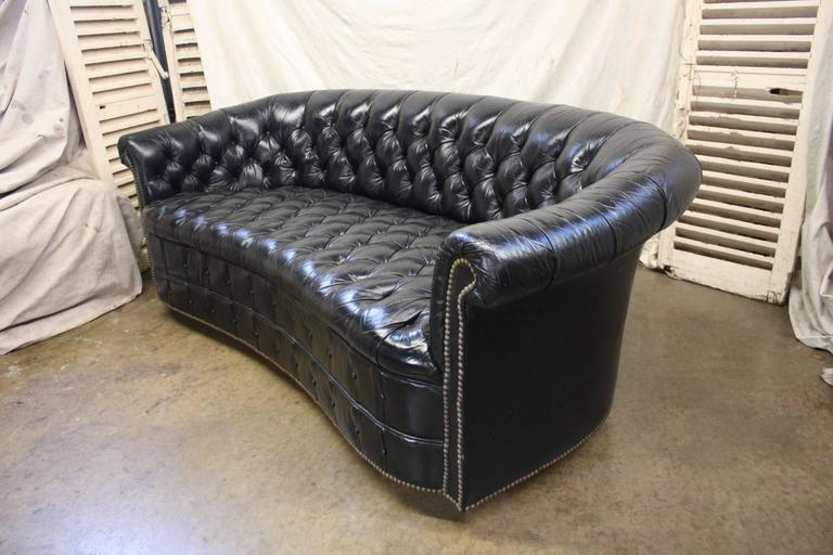 Gorgeous black leather Chesterfield.