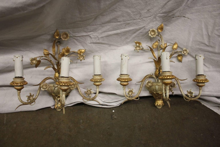 Mid-20th century pair of French painted sconces.