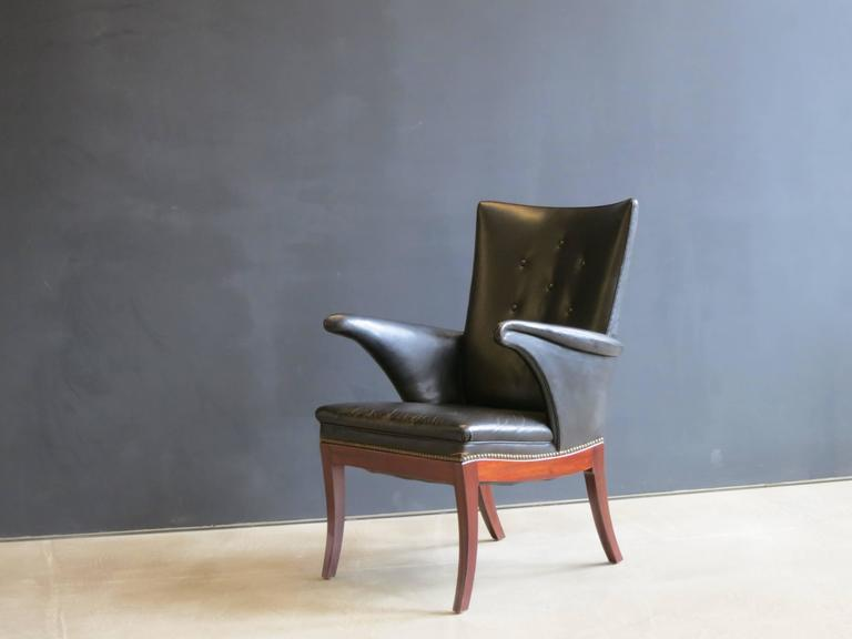 Patinated 1930s Armchair in Original Black Leather by Frits Henningsen For Sale