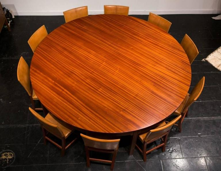 Dramatic 1930s Mahogany Dining Table by Kaare Klint. This beautiful and grand dining table of solid figured mahogany - a variant of a table made for the Danish Pavilion at the Barcelona Exposition in 1929 - was made to order by master cabinet maker