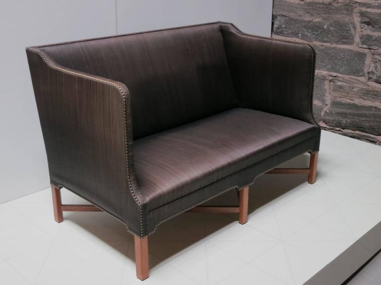 Sofa in Original Black Horsehair with Leather Welts by Kaare Klint. Made by master cabinetmaker Rud. Rasmussens Snedkerier.  With cabinetmaker's paper label on the underside, with penciled serial number 31739, and with architect's monogrammed paper
