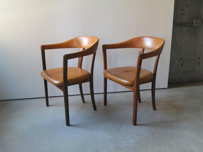 Offered by Vance Trimble, Ole Wanscher, Pair of Armchairs in Brazilian Rosewood and Nigerian Goatskin. There are three versions of this chair. Two of the versions have top rails of wood instead of leather upholstery. This version with leather