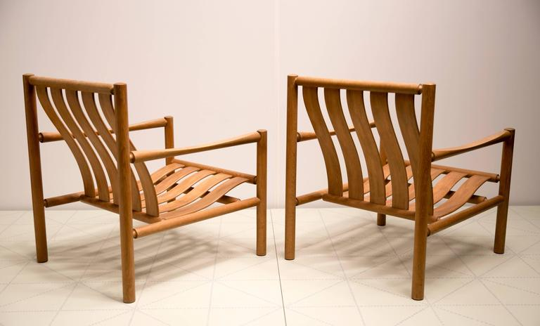 Pair of Handmade Slatted Oak Lounge Chairs by Jørgen Nilsson. This pair of rare easy chairs was designed by Jørgen Nilsson and made by the cabinetmaker J.H. Johanssens Eftf. They were first exhibited in 1964 at the Copenhagen Cabinetmakers' Guild