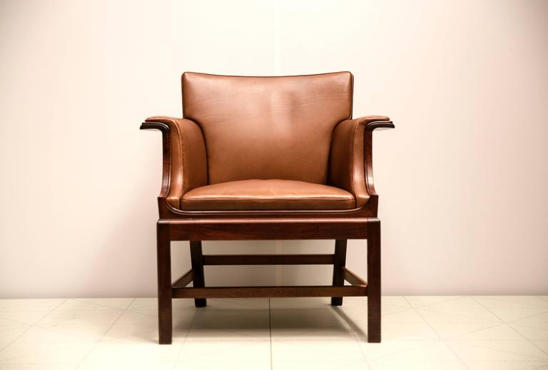 Armchair in Cuban Mahogany by Ole Wanscher.   Cabinetmaker C.B. Hansen, with metal cabinetmaker's label on the underside of the frame.  Designed in 1929 and made shortly thereafter.  Provenance: Made for the Society of Merchants Chairman's Room at