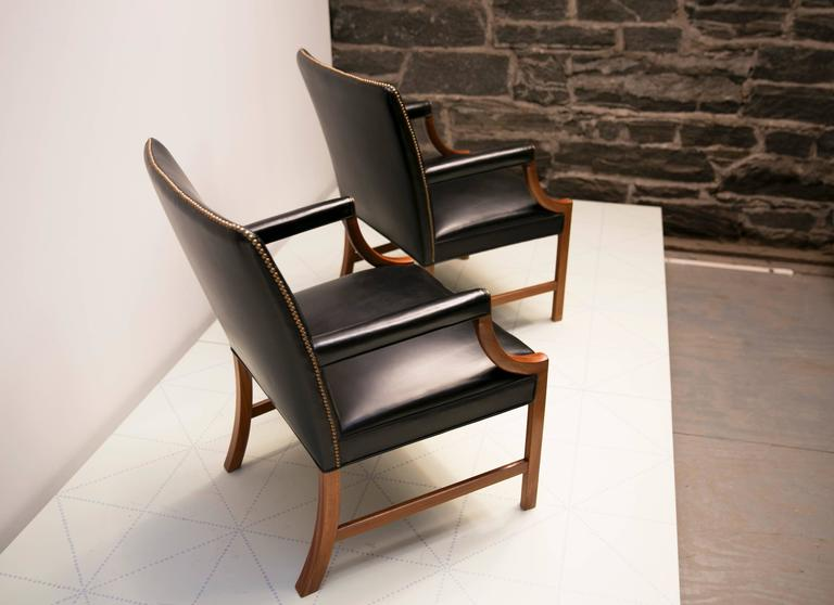 Scandinavian Modern Pair of Armchairs in Black Leather with Brass Nails and Mahogany by Ole Wanscher For Sale