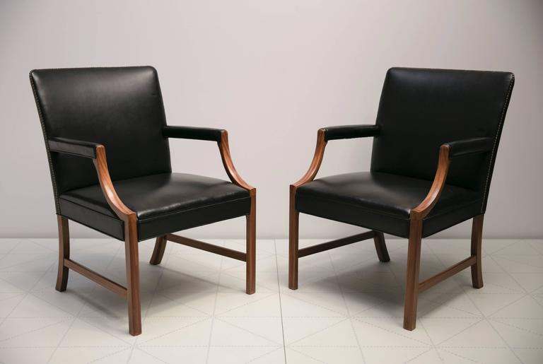 Pair of Armchairs in Black Leather with Brass Nails and Mahogany by Ole Wanscher In Excellent Condition For Sale In New York, NY